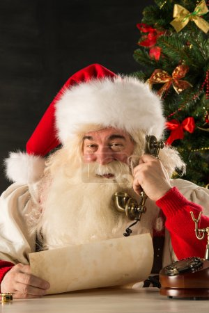 Santa Claus calling with vintage phone