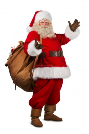 Photo for Real Santa Claus carrying big bag full of gifts, isolated on white background - Royalty Free Image