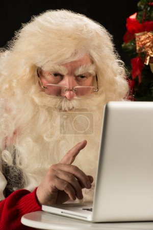 Photo for Santa Claus working on computer and having great idea - Royalty Free Image