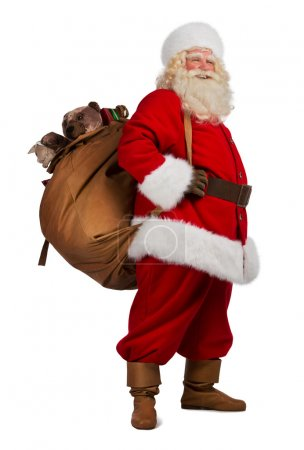 Photo for Full length portrait of Real Santa Claus carrying big bag full of gifts, isolated on white background - Royalty Free Image