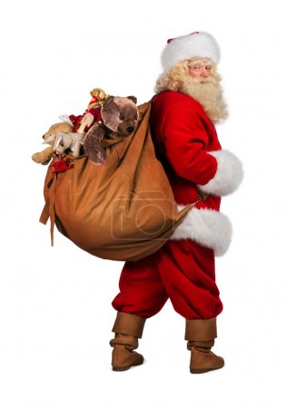 Photo for Full length portrait of Real Santa Claus carrying big bag full of gifts from behind, isolated on white background - Royalty Free Image