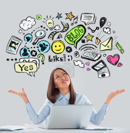 Online life concept. Business Woman looking upwards while working at office using laptop.