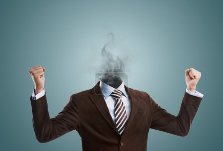 Photo for Overworked burnout business man standing headless with smoke instead of his head. Strong stress concept - Royalty Free Image