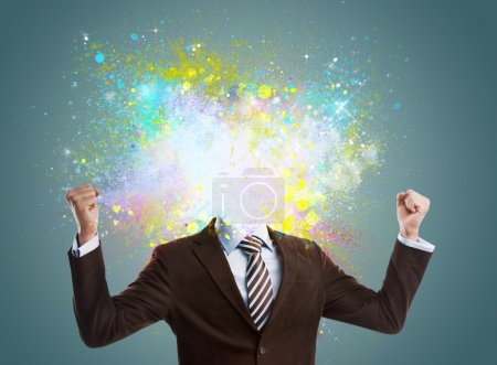 Photo for Concept of creative idea of a businessman. Colorful splashes streaming out of him. No head - Royalty Free Image