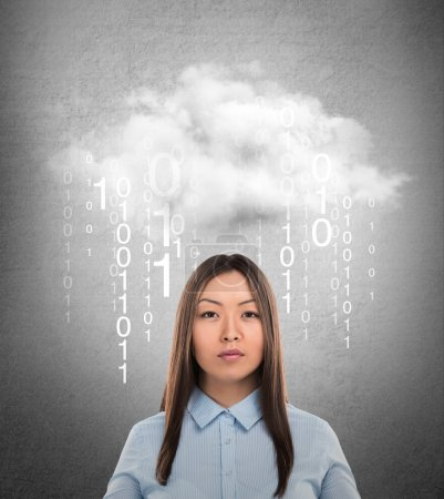 Young business woman or system administrator under cloud with digital rain.
