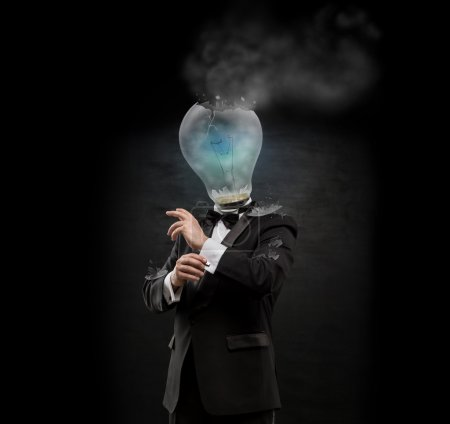 Overworked burnout business man standing headless with exploded bulb instead of his head. Strong stress concept