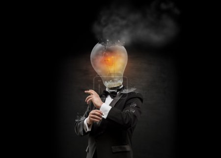 Businessman with exploded overworked lamp head