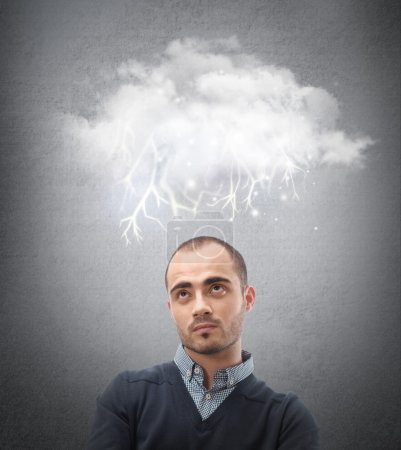 Photo for Stress, depression and despair - gloomy storm cloud raining above a businesman head - Royalty Free Image