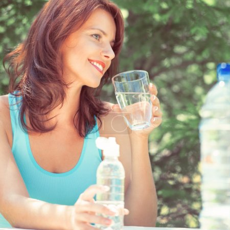Woman drinking water on picnic