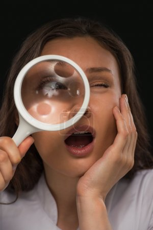 Photo for Doctor Looking Through Magnifying Glass - Royalty Free Image