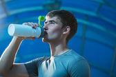 Athlete drinking water