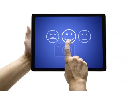 Hand touching screen with customer service evaluation form on a