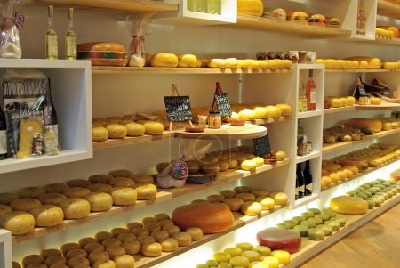 Photo for Cheese store in Europe, variation of cheese on shelves - Royalty Free Image