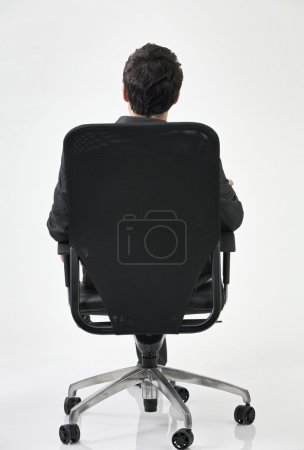 Back view of man on chair