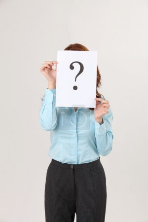 Woman holding a paper printed a big question mark