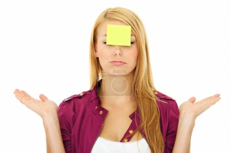 Photo for A portrait of a young confused woman with a sticky note on her forehead - Royalty Free Image
