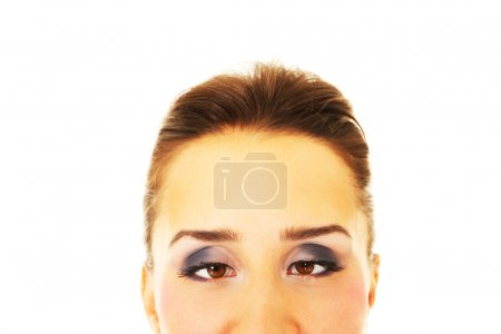 Photo for A portrait of a young woman having a squint over white background - Royalty Free Image
