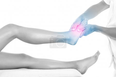 Photo for A picture of a physio therapist giving a foot massage over white background - Royalty Free Image