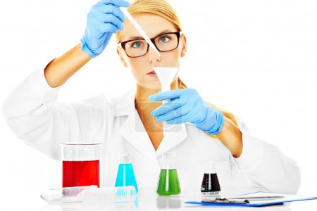 Photo for A picture of a young scientist working with test tubes over white background - Royalty Free Image