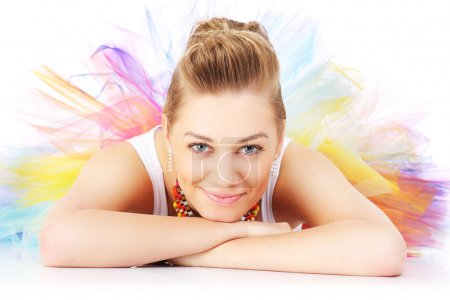 Photo for A picture of a happy ballerina lying in a colourful skirt over white background - Royalty Free Image