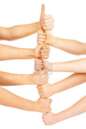 Photo pour Une photo d'une équipe de gens montrant leurs mains dans un signe de victoire sur fond blanc - image libre de droit