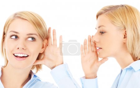 Photo for Two girls gossiping over white background - Royalty Free Image