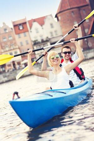 Tourists canoeing around the city
