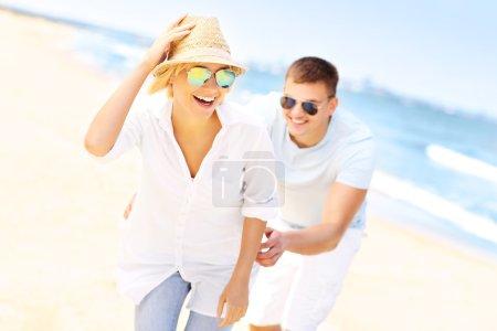 Man chasing a woman at the beach