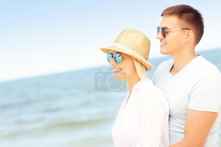 Romantic couple standing at the beach