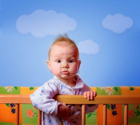 Cut baby girl in her crib