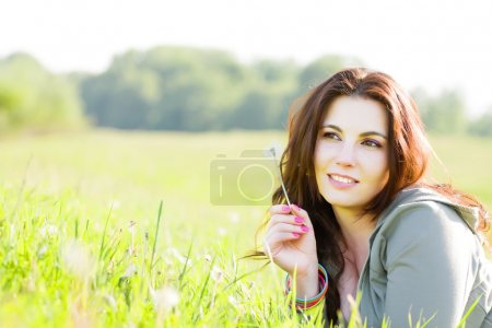 Young girl relaxing on a meadow