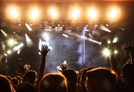 Photo for Cheering crowd in front of bright stage lights - Royalty Free Image