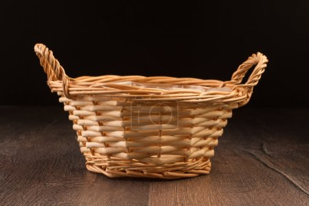 Photo for Wicker basket isolated on dark background - Royalty Free Image