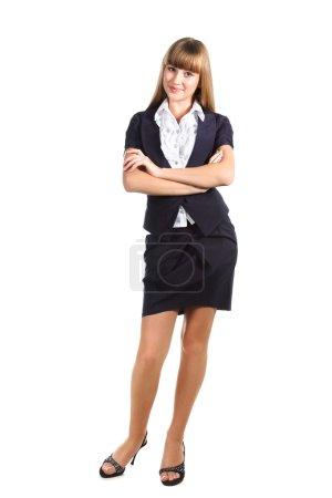 Teen schoolgirl wearing school uniform over white