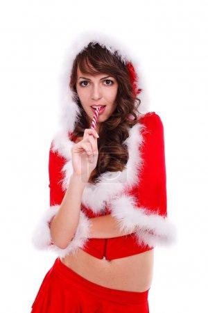 Photo pour Attrayant Mme Santa dégustation sucette, plan studio - image libre de droit