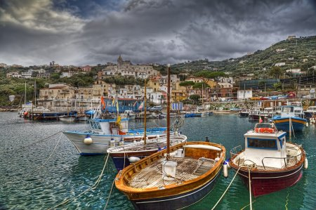 Photo for The port of Marina Lobra located in the town of Massa Lubrense is located on a small stretch of the Sorrento Peninsula. It takes its name from the church above, dedicated to Our Lady of Lobra, the patron of the place. The small harbor is presented as - Royalty Free Image