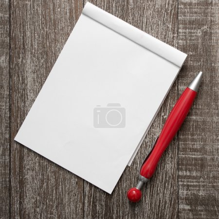 Photo for Blank notepad and pen on  wooden table, from above - Royalty Free Image