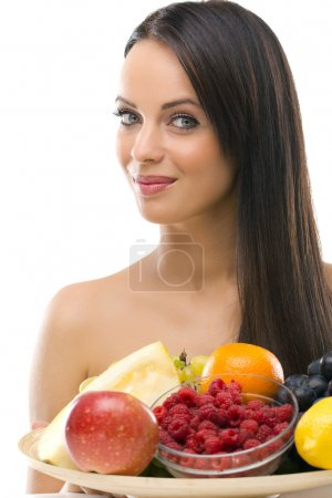 beautiful young woman holding a plate with fresh fruit