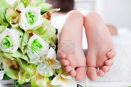 child foot ready to spa treatment