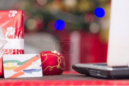 credit card and lap top,Christmas night e-shop concept