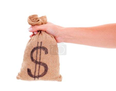 Photo pour Main de femme tenant le sac de jute avec symbole dollar - image libre de droit