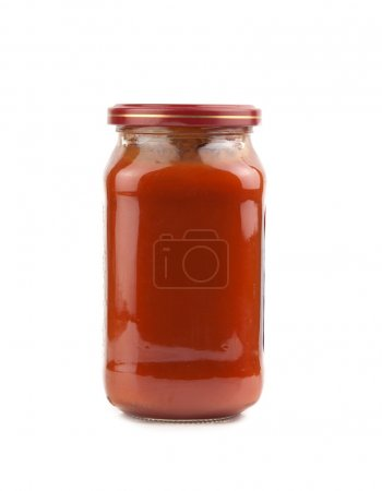 Photo for Glass jar of hot tomato sauce on a white background - Royalty Free Image