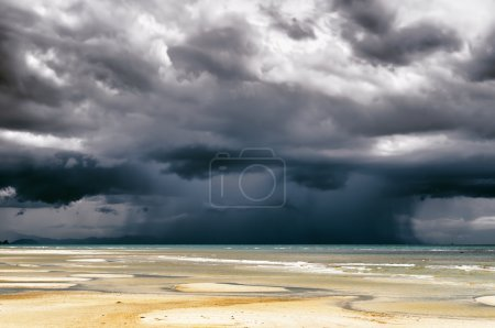 Stormy sky and beach at low tide