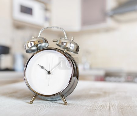 Alarm clock on a table in the kitchen