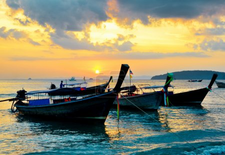 Photo for Traditional thai boats at sunset beach. Ao Nang, Krabi province. - Royalty Free Image