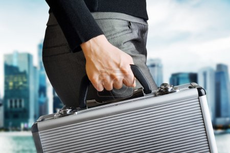 Photo for Business woman holding an aluminium briefcase. - Royalty Free Image