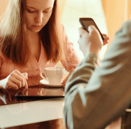 Couple ignoring each other busy with their mobile devices