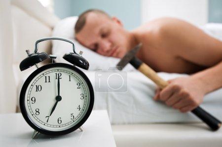 Black alarm clock and man...