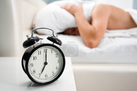 Photo for Black alarm clock and man - Royalty Free Image