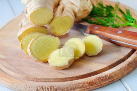 Photo for Fresh ginger and knife on the wooden board - Royalty Free Image